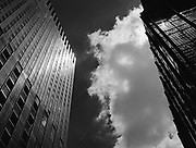 Buildings sky & clouds.  This is a view when you look up and you're in Manhattan on 3rd Avenue in Midtown.