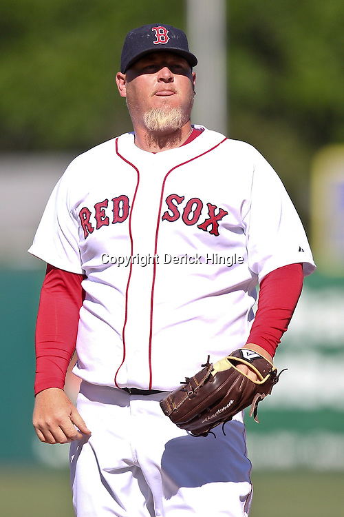 March 12, 2011; Fort Myers, FL, USA; Boston Red Sox relief pitcher Bobby Jenks (52) during a spring training exhibition game against the Florida Marlins at City of Palms Park. The Red Sox defeated the Marlins 9-2.  Mandatory Credit: Derick E. Hingle