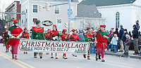 Santa's elves march in the annual Laconia Holiday Parade on Saturday and then go straight back to work at the Christmas Village due to open Thursday.   (Karen Bobotas/for the Laconia Daily Sun)