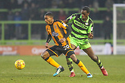 Cambridge United's Jevani Brown(20) is challenged by Forest Green Rovers Isaiah Osbourne(34) during the EFL Sky Bet League 2 match between Forest Green Rovers and Cambridge United at the New Lawn, Forest Green, United Kingdom on 20 January 2018. Photo by Shane Healey.