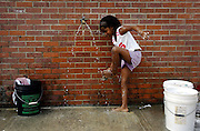 A quick wash helps lift the spirits of Deijhane Powell, 7, of Biloxi, who has been staying in a shelter with her mother, Koshena Powell. Their home on Lee Street was destroyed by Hurricane Katrina and they have been staying in the shelter at Mary L. Mitchell 7th Grade School since.