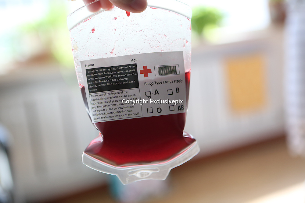 """BENXI, CHINA - JUNE 25: (CHINA OUT) <br /> <br /> Blood Bag Beverage<br /> <br /> """"Blood Bag"""", a crimson beverage offered with two flavors of blueberry and cranberry, is seen on June 25, 2014 in Benxi, Liaoning province of China. """"Blood Bag"""", a crimson beverage was marked by the sign of """"Blood Type Energy Supply"""" and the symbol of Red Cross and the beverage was for sale with the price of 30 RMB (about 4.8 USD) in China\s northeast city of Benxi.<br /> ©Exclusivepix"""
