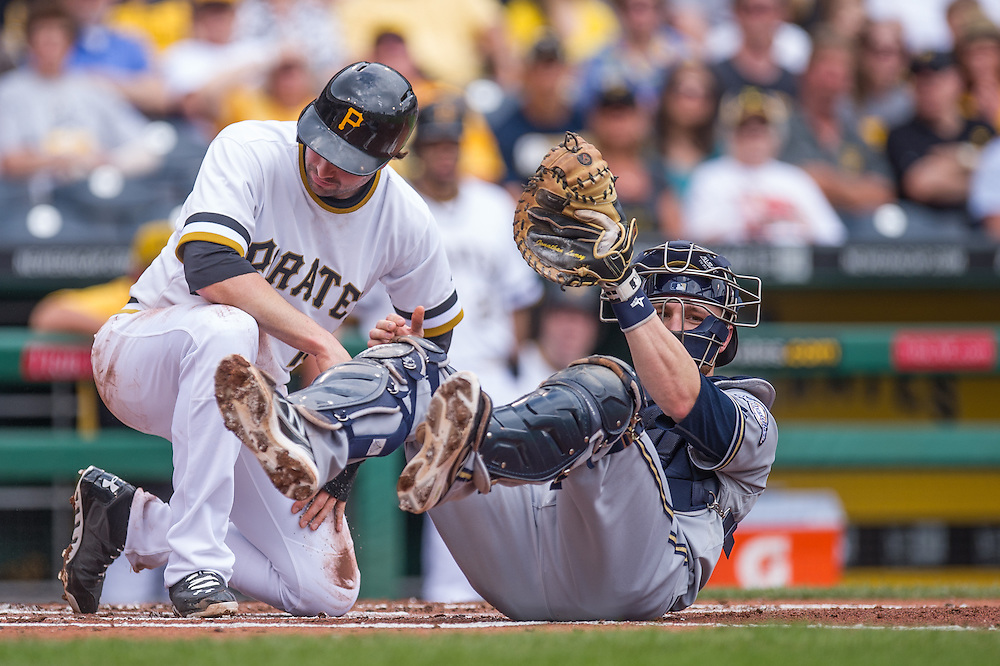 PITTSBURGH, PA - JUNE 08: Jonathan Lucroy #20 of the Milwaukee Brewers tags out Neil Walker #18 of the Pittsburgh Pirates at home plate during the game between the two teams at PNC Park on June 8, 2014 in Pittsburgh, Pennsylvania. (Photo by Rob Tringali) *** Local Caption *** Jonathan Lucroy;Neil Walker
