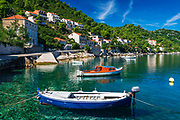 Fishing boats and blue waters in the village of Sobra, Mljet Island, Croatia