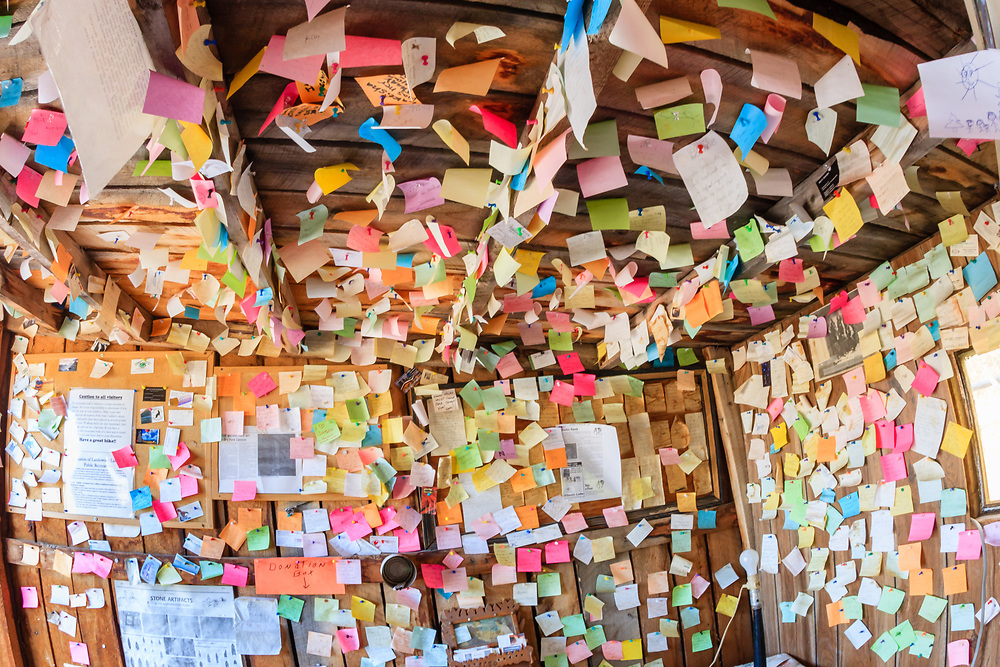 Notes line the walls and ceiling of a guest cabin on the McConkie Ranch in Vernal, Utah.