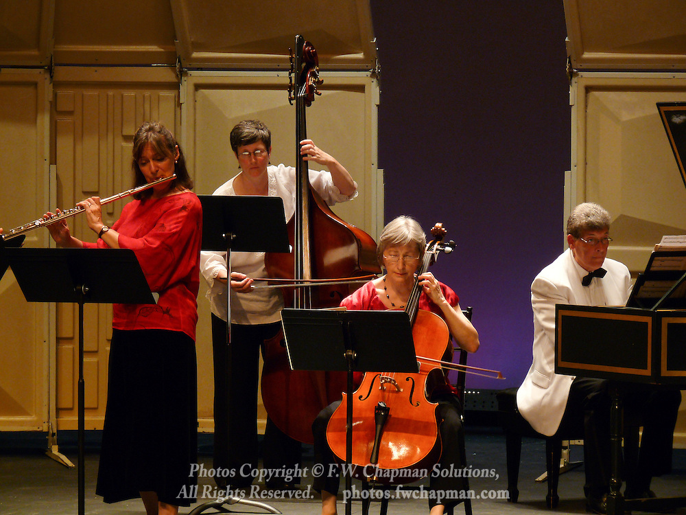 Valley Vivaldi players Robin Kani, flute, Nancy Merriam, bass, Deborah Davis, cello, and Allan Birney, harpsichord, perform in a Sunday evening concert starting at 7:30 PM on June 28, 2009 at Cedar Crest College in Allentown, Pennsylvania, USA.