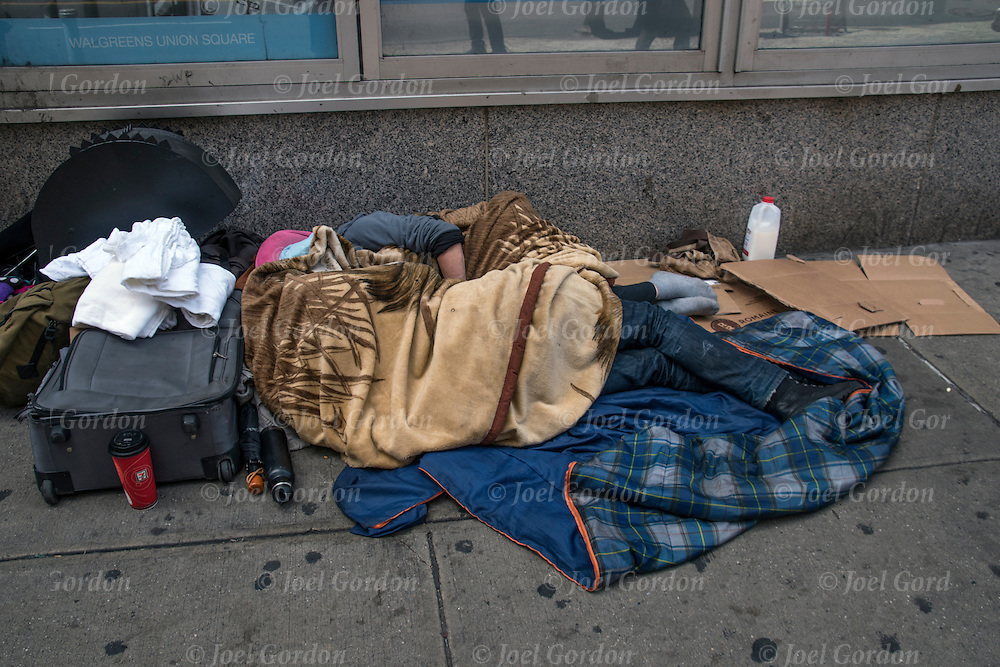 Homeless street couple a sleep on the street in New York City. <br />