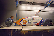 De VeloX4 wordt klaar gemaakt voor de test. In Delft test het Human Power Team Delft en Amsterdam (HPT) hun nieuwe fiets, de VeloX4, in de windtunnel. In september wil het HPT, dat bestaat uit studenten van de TU Delft en de VU Amsterdam, een poging doen het wereldrecord snelfietsen te verbreken, dat nu op 133,8 km/h staat tijdens de World Human Powered Speed Challenge.<br /> <br /> The Human Power Team Delft and Amsterdam (HPT) test their new bike, the VeloX4, in the wind tunnel in Delft. With the special recumbent bike the HPT, consisting of students of the TU Delft and the VU Amsterdam, also wants to set a new world record cycling in September at the World Human Powered Speed Challenge. The current speed record is 133,8 km/h.