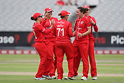 Lancashire Thunders Danielle Hazell (Captain) congratulates Lancashire Thunders Kate Cross during the Women's Cricket Super League match between Lancashire Thunder and Surrey Stars at the Emirates, Old Trafford, Manchester, United Kingdom on 7 August 2018.