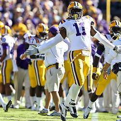 November 6, 2010; Baton Rouge, LA, USA;  LSU Tigers linebacker Kelvin Sheppard (11) celebrates following an interception during the first half against the Alabama Crimson Tide at Tiger Stadium.  Mandatory Credit: Derick E. Hingle