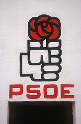 PSOE  Spanish Labour Party  logo on side of building featuring hand holding a rose,