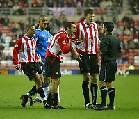 Photo. Andrew Unwin<br /> Sunderland v Wigan Athletic, Nationwide League Division One, Stadium of Light, Sunderland 02/12/2003.<br /> Sunderland players Kevin Kyle (r) and Jeff Whitley (l) appeal to the referee, Mr A Kaye, after their teammate Julio Arca (c) is sent off for diving.