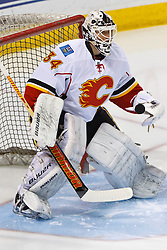 Jan 17, 2012; San Jose, CA, USA; Calgary Flames goalie Miikka Kiprusoff (34) warms up before the game against the San Jose Sharks at HP Pavilion. San Jose defeated Calgary 2-1 in shootouts. Mandatory Credit: Jason O. Watson-US PRESSWIRE