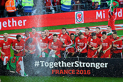 CARDIFF, WALES - Tuesday, October 13, 2015: Wales players celebrate after qualifying for the finals following a 2-0 victory over Andorra during the UEFA Euro 2016 qualifying Group B match at the Cardiff City Stadium. Jonathan Williams, Joe Allen, Joe Ledley, Chris Gunter, Gareth Bale, Aaron Ramsey, Neil Taylor, Simon Church, Andy King, Emyr Huws, Ben Davies, Wes Burns, Tom Lawrence, Sam Vokes, James Chester, Ashley 'Jazz' Richards, goalkeeper Owain Fon Williams. (Pic by Paul Currie/Propaganda)