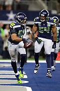 Seattle Seahawks outside linebacker K.J. Wright (50) celebrates with Seahawks middle linebacker Bobby Wagner (54) after intercepting a fourth quarter pass that stops a Cowboys drive at the Seahawks 16 yard line during the NFL football NFC wild card playoff game against the Dallas Cowboys on Saturday, Jan. 5, 2019 in Arlington, Tex. The Cowboys won the game 24-22. (©Paul Anthony Spinelli)