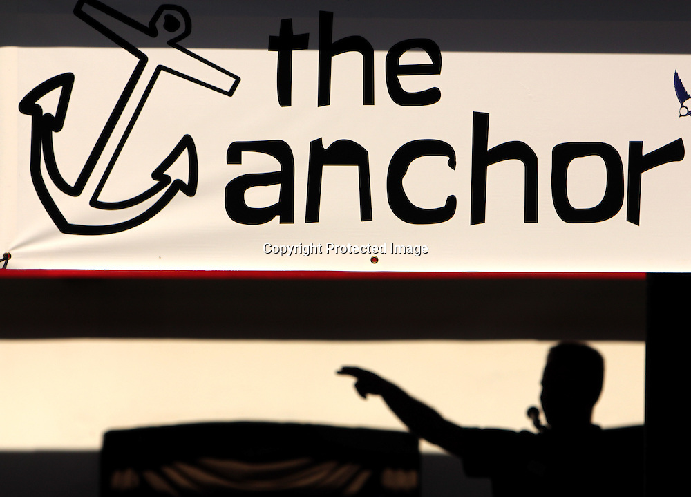 Pastor Philip Chryst delivers a sermon at The Anchor Sunday June 1, 2014 on the Wilmington, N.C. waterfront. (Jason A. Frizzelle)