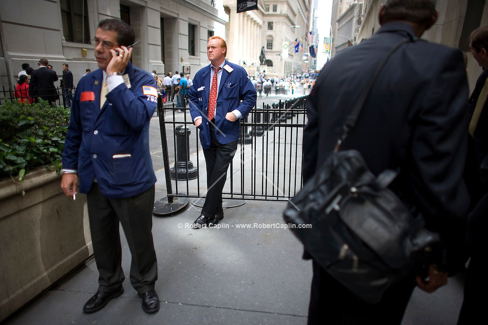Broker Terry Toal outside the New York Stock Exchange on a turbulent day in the financial world.   Lehman Brothers, burdened by $60 billion in soured real-estate holdings, filed a Chapter 11 bankruptcy petition in U.S. Bankruptcy Court after attempts to rescue the 158-year-old firm failed. Bank of America Corp. said it is snapping up Merrill Lynch & Co. Inc. in a $50 billion all-stock transaction. Sept 15, 2008. Robert Caplin For The Wall Street Journal