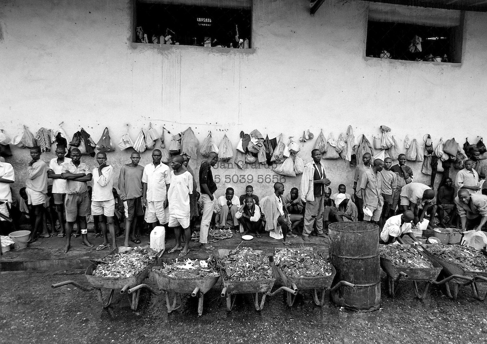 After the genocide, the Tutsis launched a violent hunt for the Hutus behind the killings. Rwanda&rsquo;s government created temporary jails to house the several hundred thousand suspects, who waited &ndash; and are still waiting &ndash; to be tried. Some of them were packed into an abandoned coffee factory in Kigali. 1994 -<br /> The sun had set over the rwandan capital Kigali as president Juvenal Habyarimana's plane approached the city's airport on 6.april 1994.Suddenly, out of the darkness, a rocket hit the plane and sent it crashing to the ground, killing everyone on board.over the next three month's, more than 800.000 rwandans would be murdered, many cut down with machetes, killed by neighbours and countrymen, in a ferocious ethnic genocide that was all but ignored by the international world.