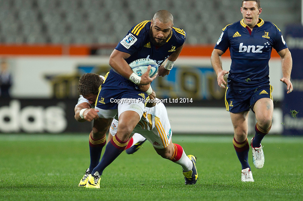 Patrick Osbourne of the Highlanders is tackled during the Super Rugby game between The Chiefs and The Highlanders, Forsyth Barr Stadium, Dunedin. 27 June 2014. Photo: Teaukura Moetaua/www.photosport.co.nz