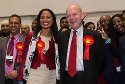 © Licensed to London News Pictures. 12/06/2015. London, UK. Labour's JOHN BIGGS and RUSHANARA ALI with Labour party supporters at the Excel Centre in London celebrate after winning the Tower Hamlets Mayor election. Lutfur Rahman was removed from office for fraud and corrupt practices by an election court earlier this year and the 2014 election was rerun as a result. Photo credit : Vickie Flores/LNP