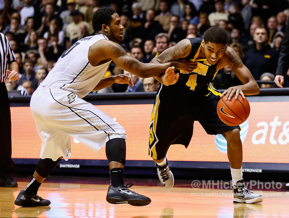 WEST LAFAYETTE, IN - JANUARY 27: Roy Devyn Marble #4 of the Iowa Hawkeyes dribbles to the hoop as Terone Johnson #0 of the Purdue Boilermakers guards at Mackey Arena on January 27, 2013 in West Lafayette, Indiana. Purdue defeated Iowa 65-62 in overtime. (Photo by Michael Hickey/Getty Images) *** Local Caption *** Roy Devyn Marble; Terone Johnson
