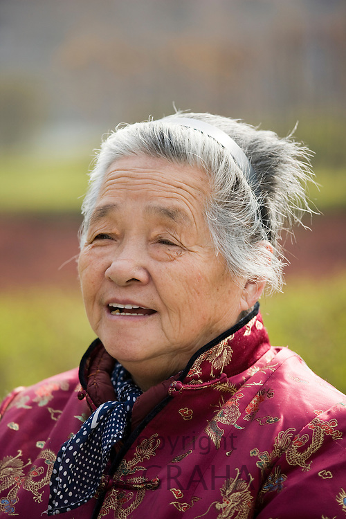 Elderly woman in the park by the City Wall, Xian, China