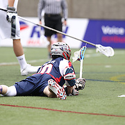 Stephen Berger #10 of the Boston Cannons watches his shot as he falls to the ground during the game at Harvard Stadium on April 27, 2014 in Boston, Massachusetts. (Photo by Elan Kawesch)