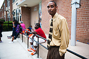 Nicholson Technology Academy's Dean of Students Mr. Cooper stands outside his school in the Englewood neighborhood.
