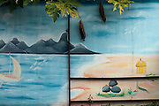 Painted steel wall with a landscape showing coast and Pieter Both mountain.<br /> at a Hindu temple.