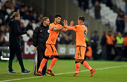 LONDON, ENGLAND - Saturday, November 4, 2017: Liverpool's Roberto Firmino is replaced by substitute Dominic Solanke during the FA Premier League match between West Ham United FC and Liverpool FC at the London Stadium. (Pic by David Rawcliffe/Propaganda)