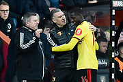Subsitution - Goalscorer Abdoulaye Doucoure (16) of Watford walks off the field and congratulated by Watford manager Nigel Pearson during the Premier League match between Bournemouth and Watford at the Vitality Stadium, Bournemouth, England on 12 January 2020.
