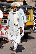 Indian man in traditional dhoti trousers and turban at Sardar Market at Girdikot, Jodhpur, Rajasthan, Northern India
