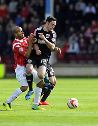 Bristol City's Greg Cunningham battles for the ball with Walsall's Adam Chambers  - Photo mandatory by-line: Joe Meredith/JMP - Mobile: 07966 386802 12/04/2014 - SPORT - FOOTBALL - Walsall - Banks' Stadium - Walsall v Bristol City - Sky Bet League One