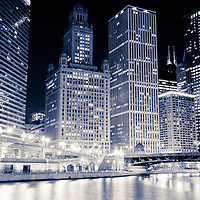 Chicago downtown at night along the Chicago River with 35 East Wacker Drive Building, Unitrin Building, Renaissance Chicago Hotel, Leo Burnett Building and Irv Kupcinet Bridge (Wabash Avenue Bridge)