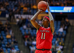 Jan 2, 2019; Morgantown, WV, USA; Texas Tech Red Raiders forward Tariq Owens (11) shoots a three pointer during the first half against the West Virginia Mountaineers at WVU Coliseum. Mandatory Credit: Ben Queen-USA TODAY Sports