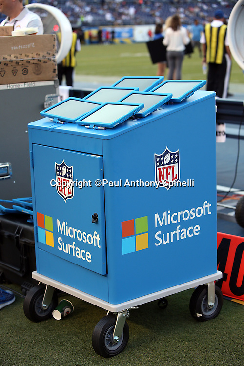 A tablet storage cart holds play tablets before the San Diego Chargers 2015 NFL preseason football game against the Dallas Cowboys on Thursday, Aug. 13, 2015 in San Diego. The Chargers won the game 17-7. (©Paul Anthony Spinelli)