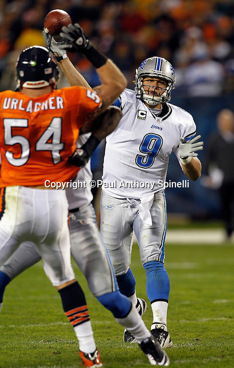 Detroit Lions quarterback Matthew Stafford (9) throws a pass over Chicago Bears middle linebacker Brian Urlacher (54) during the NFL week 10 football game against the Chicago Bears on Sunday, November 13, 2011 in Chicago, Illinois. The Bears won the game 37-13. ©Paul Anthony Spinelli