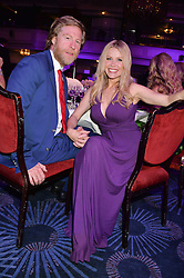 MELINDA MESSENGER and WARREN SMITH at the Caudwell Children's annual Butterfly Ball held at The Grosvenor House Hotel, Park Lane, London on 15th May 2014.