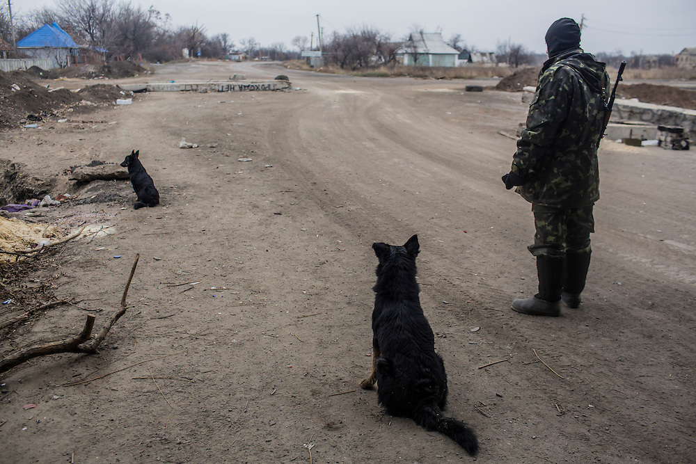 PERVOMAISKE, UKRAINE - NOVEMBER 18, 2014: Yura, a member of the 5th platoon of the Dnipro-1 brigade, a pro-Ukraine militia, keeps watch at their post underneath a bridge in Pervomaiske, Ukraine. CREDIT: Brendan Hoffman for The New York Times