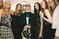German fashion designer Karl Lagerfeld and some models after the presentation of his Ready-to-Wear Fall-Winter 2005-2006 collection for French fashion house Chanel. Paris, France on March 4, 2005. Photo by ABACA.