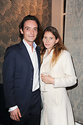 The EARL & COUNTESS OF LICHFIELD at the opening of Luke Irwin's showroom at 22 Pimlico Road, London SW1 on 24th November 2010.