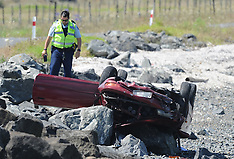 Thames-Car crashes onto rocks at Awarua Bay