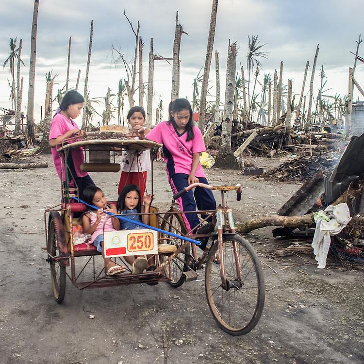 A group of girls riding a rickshaw in Tanauan.