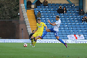 AFC Wimbledon defender Paul Robinson (6) battles for possession during The Emirates FA Cup 1st Round match between Bury and AFC Wimbledon at the JD Stadium, Bury, England on 5 November 2016. Photo by Stuart Butcher.