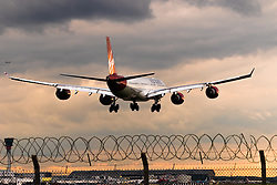 A Virgin Atlantic Airbus A340 lands at London's Heathrow Airport (LHR / EGLL).