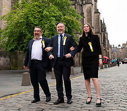 Edinburgh, Scotland, UK. 27 May, 2019. The six new Scottish MEPs are declared at the City Chambers in Edinburgh, SNP's Alyn Smith, Christian Allard and Aileen McLeod, Louis Stedman-Bruce from the Brexit Party, Sheila Ritchie of the Liberal Democrats and Baroness Nosheena Mobarik of the Conservatives. Pictured l to r SNP's  Christian Allard, Alyn Smith,  and Aileen McLeod,