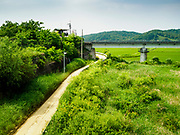 "09 JUNE 2018 - IMJINGAK, PAJU, SOUTH KOREA: A South Korean lookout at the foot of the  ""Freedom Bridge"" from the South Korean side of the Korean DMZ in Imjingak. The bridge, now closed, is called the Freedom Bridge because it is the bridge POWs returning to the South crossed when they were releases by North Korea after the cease fire was signed. The Bridge could be reopened for train traffic if a peace treaty is signed with North Korea. Imjingak is a park and greenspace in South Korea that is farthest north most people can go without military authorization. The park is on the south bank of Imjin River, which separates South Korea from North Korea and is close the industrial park in Kaesong, North Korea that South and North Korea have jointly operated.     PHOTO BY JACK KURTZ"