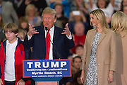 Republican presidential candidate billionaire Donald Trump introduces his daughters Ivanka, right, and son Barron, left, during a campaign rally at the Myrtle Beach Convention Center November 24, 2015 in Myrtle Beach, South Carolina.