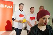 Fatima Elitak met achter haar jongeren tijdens de ledenraad. In Utrecht wordt een speciale ledenraad van de PvdA gehouden. Tijdens de vergadering wordt gesproken over het afscheid van Job Cohen en over de toekomst van de partij.<br /> <br /> Fatima Elitak is waiting with a few young members. In Utrecht, a special council of the PvdA (Dutch Labour Party) is held . During the meeting the members discussed the departure of Job Cohen as leader and the future of the party
