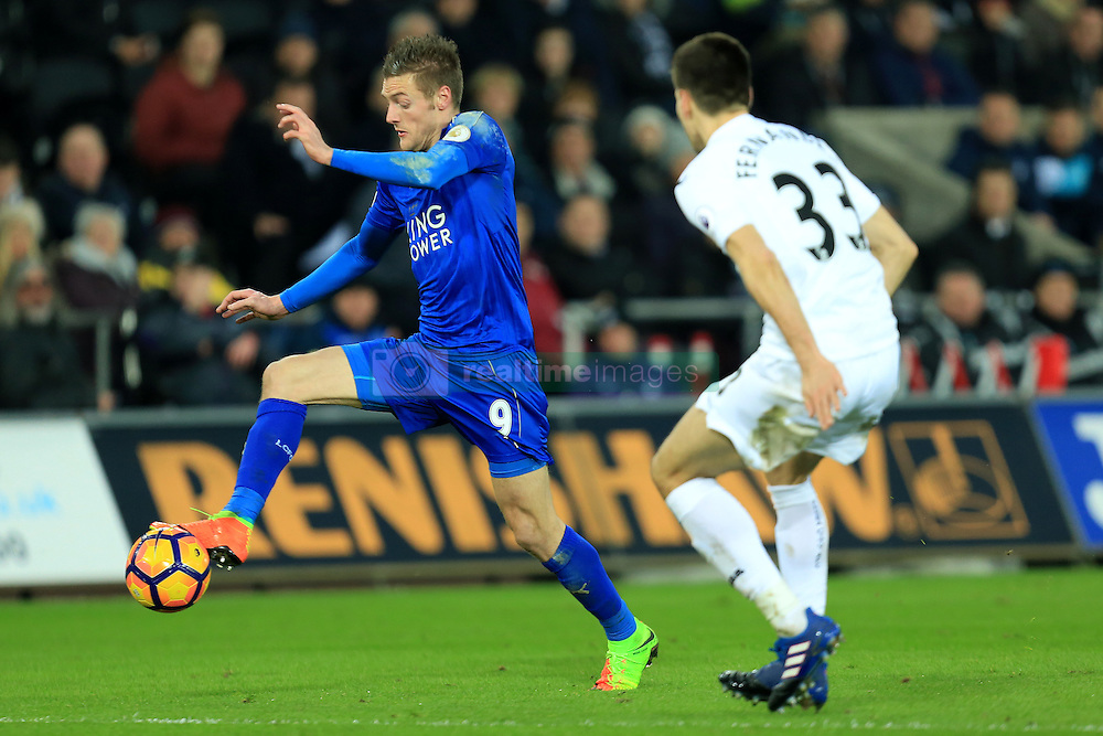 12 February 2017 - Premier League - Swansea City v Leicester City - Jamie Vardy of Leicester City controls the ball as Federico Fernandez of Swansea City closes in - Photo: Paul Roberts / Offside